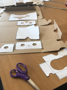 DIY VR Goggle template and cardboard laid out on table
