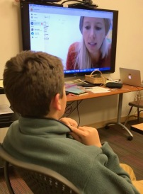 picture of boy watching Skye interview on monitor